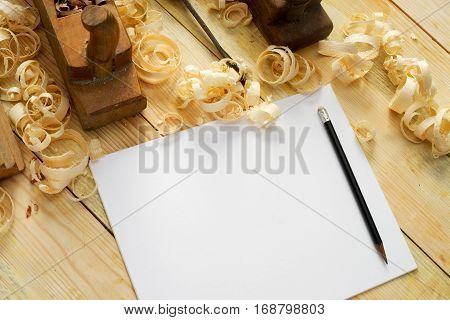 White sheet on wooden table for carpenter tools with sawdust. Copy space. Top view. poster