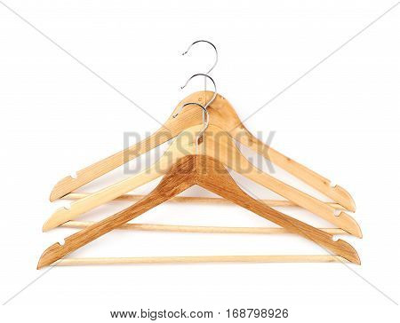 Pile of light wooden hangers isolated over the white background