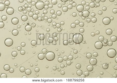 Flowing air bubbles soars over a golden background