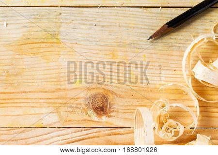 Carpenter tools on wood table background with sawdust. Copy space