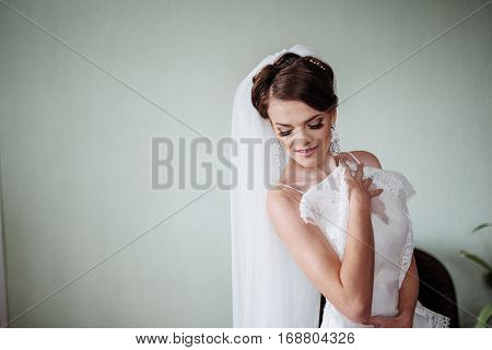 Bride trying on dress, wedding day the happiest