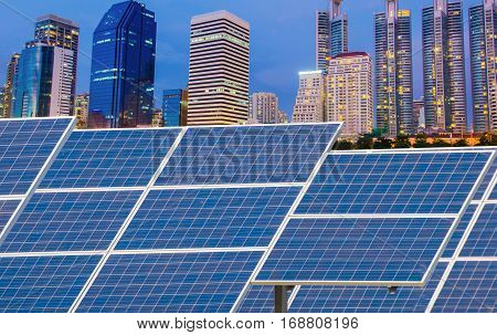 Solar Panels In Front Of Modern Office Building At Night
