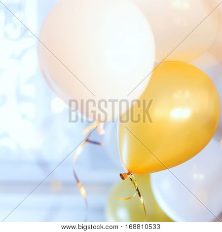 Colorful balloons filled with helium of a high ceiling.