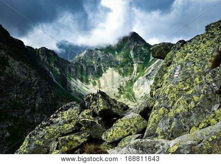 Landscape background Dark clouds over a mountain valley