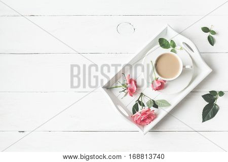 Morning. Vintage. Cup of coffee and rose flowers. Flat lay top view