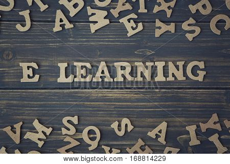 Word elearning on a dark wooden background