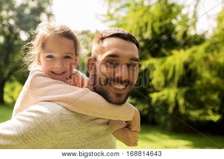 family, parenthood, fatherhood and people concept - happy father and little girl having fun in summer park