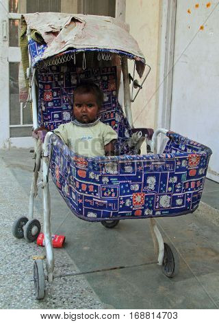 Girl In Baby Carriage, Jaipur