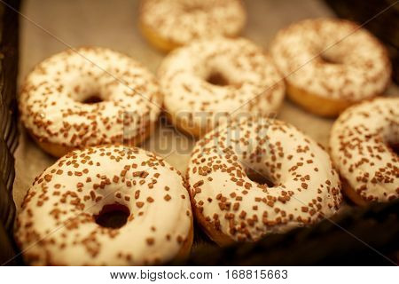 food, baking and sale concept - close up of donuts at bakery or grocery store