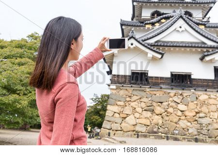Woman taking photon on Hikone castle