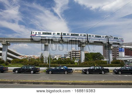 Osaka, Japan - Aug 10, 2015: Osaka Monorail And Taxi Near The Osaka International Airport