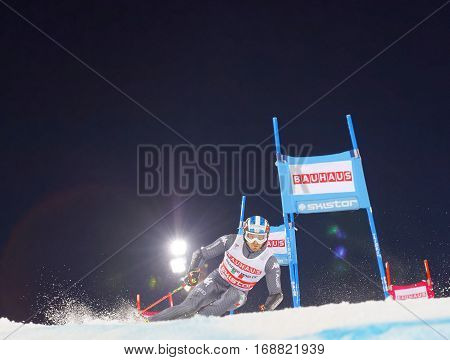 STOCKHOLM SWEDEN - JAN 31 2017: Manfred Moeigg (ITA) squirting snow in the downhill skiing in the parallel slalom alpine event Audi FIS Ski World Cup. January 31 2017 Stockholm Sweden