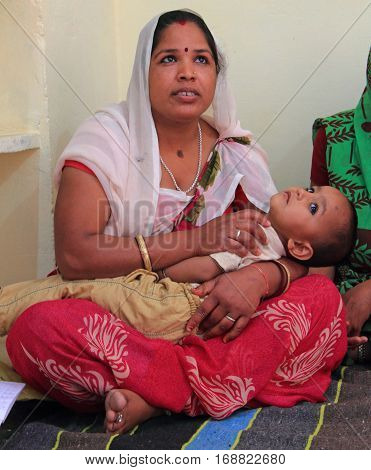 Women With Son Are Visiting Educational Center In Jaipur, India