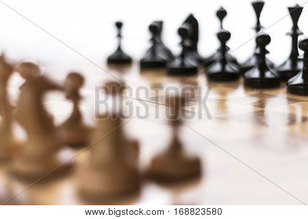 Blurred chess background. Chess set on the chess board.