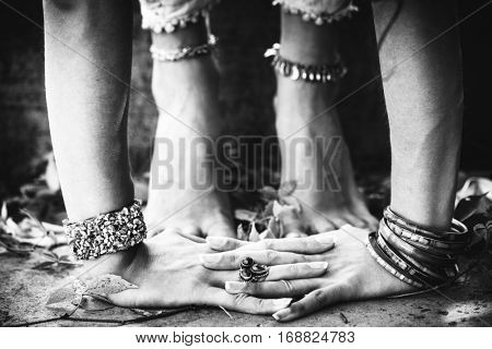 closeup of woman hands and feet practice yoga extension outdoor black and white