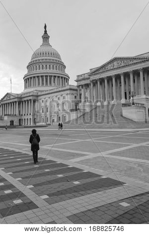 A female tourist in front of the United States Capitol - Washington DC USA