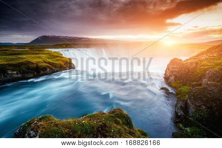 The rapid flow of water powerful Godafoss cascade. Popular tourist attraction. Unusual and gorgeous scene. Location place Bardardalur valley, Skjalfandafljot river, Iceland, Europe. Beauty world.