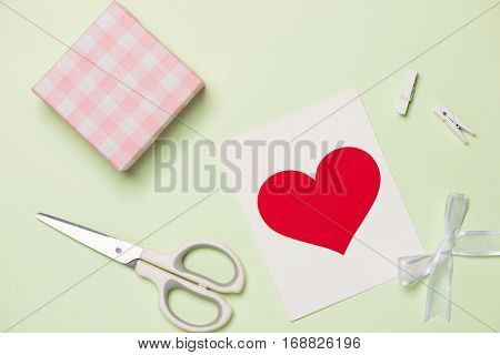 Packing Holiday Gifts For Valentine's Day On Green Background.