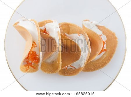 Thai Traditional Snack and Dessert Top View of Thai Crispy Pancake or Thai Crepes Filled with Coconut Cream and Salted Shredded Coconut Isolated on White Background.