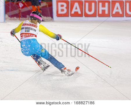STOCKHOLM SWEDEN - JAN 31 2017: Rear view of Frida Hansdotter (SWE) in the parallel slalom downhill skiing at the Alpine Audi FIS Ski World Cup - city event January 31 2017 Stockholm Sweden