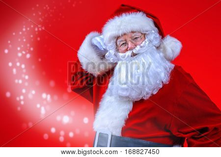 Christmas concept. Close-up portrait of a fairytale Santa Claus over red bakground. Good old traditions. Family holidays.