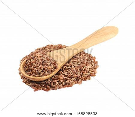 Pile of brown rice grains with the wooden spoon over it, composition isolated over the white background