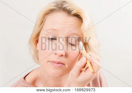 Woman Applying Eyeshadow On Left Eyelid
