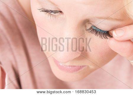 Woman Applying False Eyelashes