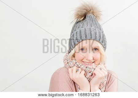 Lady Wearing Scarf And Pom Winter Hat With Copy Space