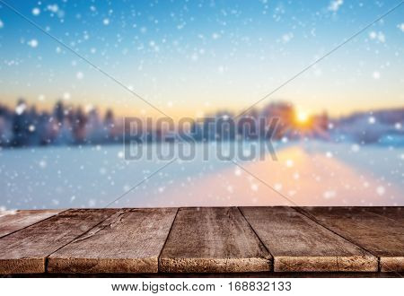 Empty wooden planks with winter mountains. Beautiful sunset light Ideal for product placement