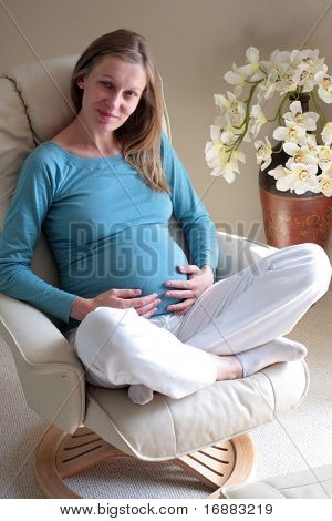 relaxed pregnant woman on chair