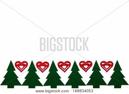 ornament with figurines of christmas tree and hearts made of felt horizpntal background with copy space. flat lay.