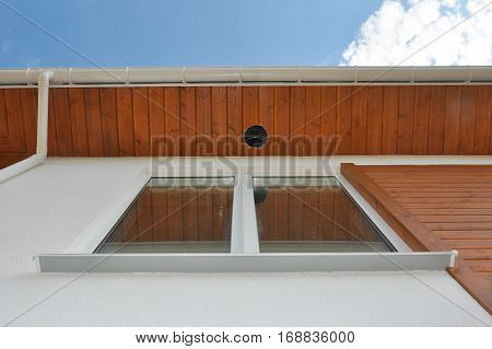 Close up on Outdoor Lighting & Exterior Light Fixtures. Rain Gutter Soffit Board Fascia Board Installation. Outdoor House Lighting Installation. Gutter Pipeline. poster