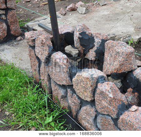 Building Granite Stone Fence with Doorway Outdoor.
