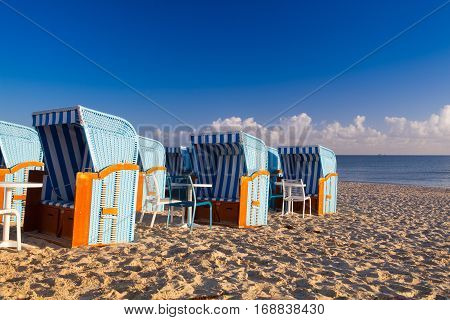 Sandy beach and traditional wooden beach chairs on Rugen island Northern Germany on the coast of Baltic Sea