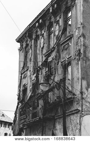 Facade of the destroyed building with classical moldings.