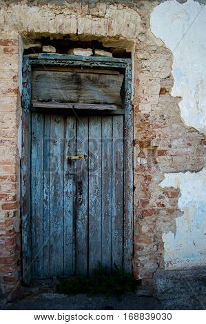 Old locked door in a shabby and cracks with a new lock.