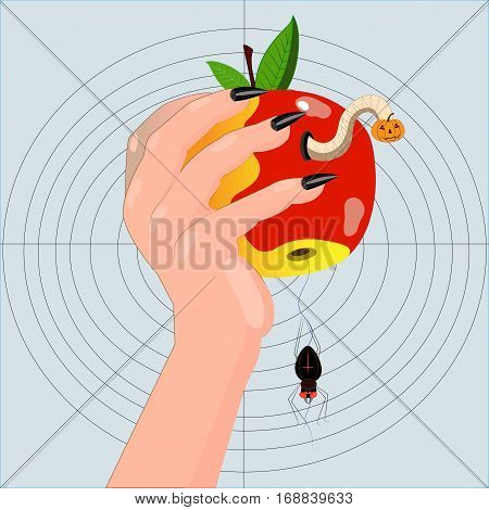 The hand of the person holds worm-eaten apple