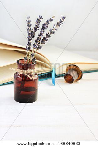 Lavender twigs in dark glass bottle, home natural floral deodorant.
