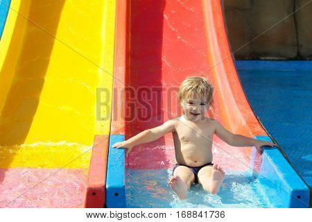 Happy Cute Baby Boy Rides From Waterslide