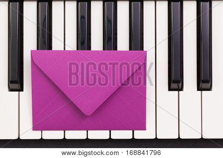 Funny arrangement envelope on the piano keybords - Flat lay image