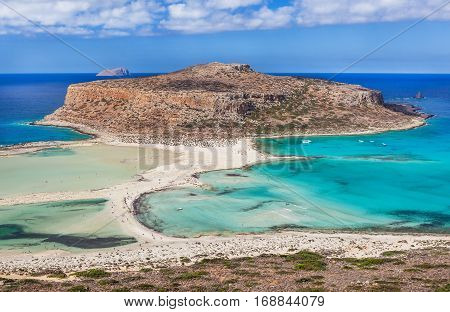 Amazing view of Balos bay on Crete island Greece. Tourists relax and bath in crystal clear azure water of Balos beach.
