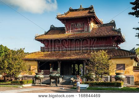 Hue, Vietnam -November 11, 2015: Pagoda with tourists standing in front of it in Imperial Palace