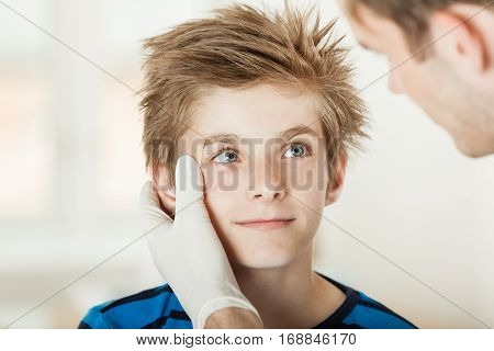 Young Boy Eye Examination By Doctor