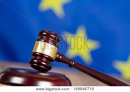Judge hammer with European flag a background