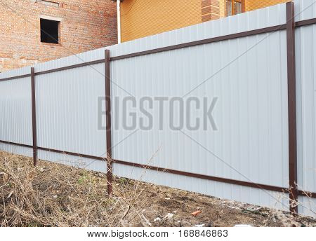 New Profile Metal Fence constraction. Intall steel fence. Fencing.