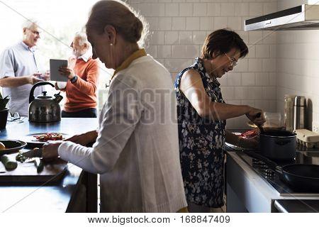 Senior Friends Cooking Food Kitchen
