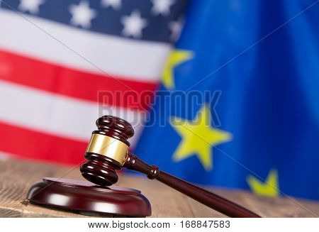 Judge hammer with United States flags and European flag
