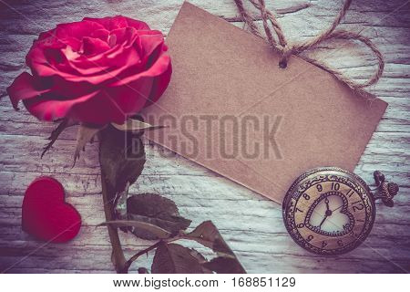 Red rose flower Valentine's day and Sweetest day vintage toned Holiday background with copy space.