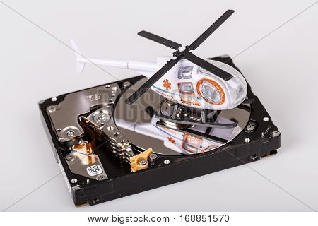 ambulance helicopter or chopper on harddrive or hdd - data backup safe and rescue concept
